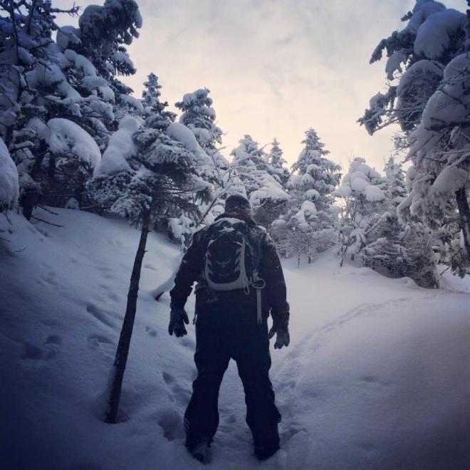 Man standing in snowy trail