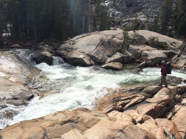 Man next to rushing river