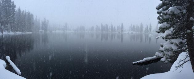 Snow falling on lake