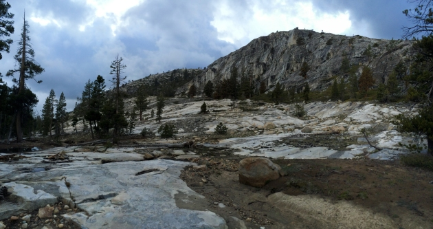 Granite canyon with dark clouds in the sky