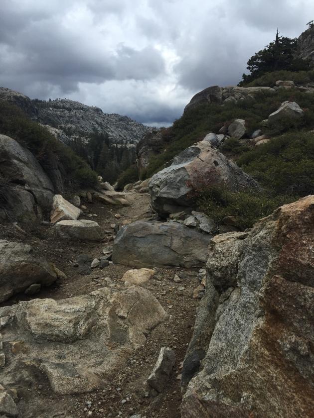 Granite mountains with dark gray skies