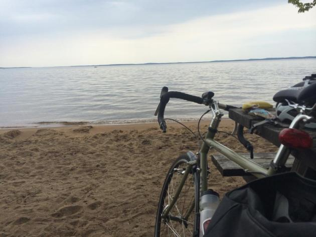 Bike on beach facing lake