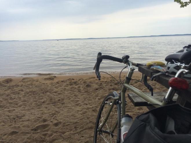Bike on beach facing lake