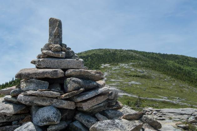 Pile of rocks with mountain peak in the background