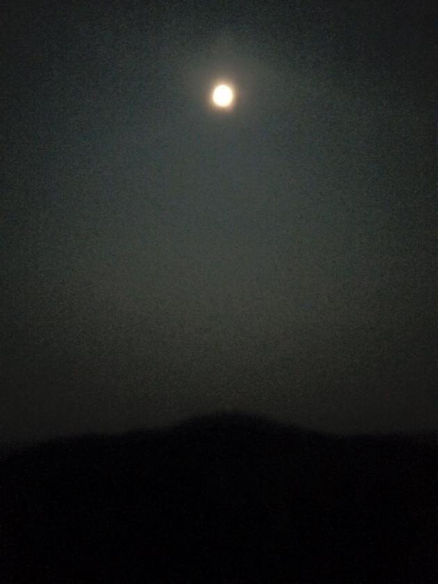 Moon over dark mountain