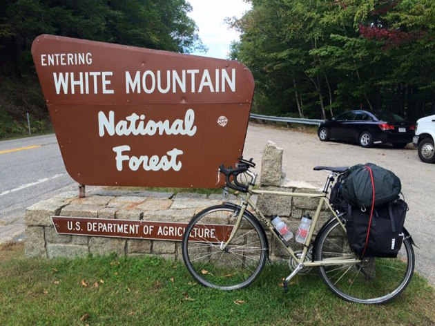 Bike next to national park sign