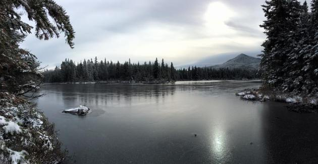 Frozen pond with mountains