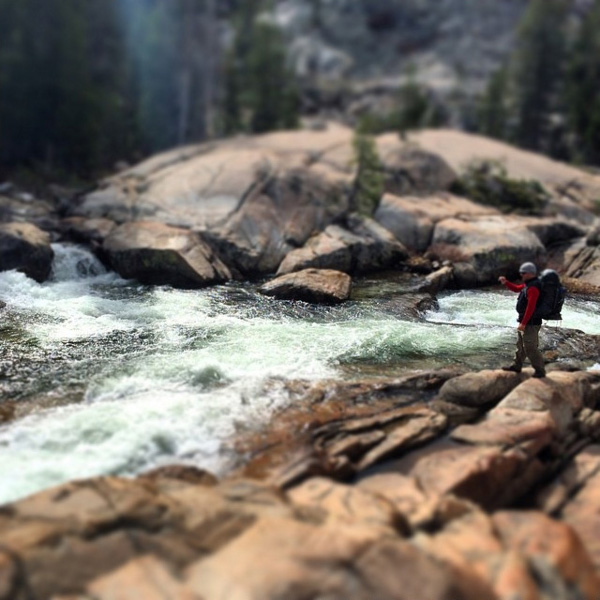 Man beside rapids