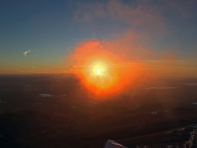 Small cloud brightly lit by sunrise