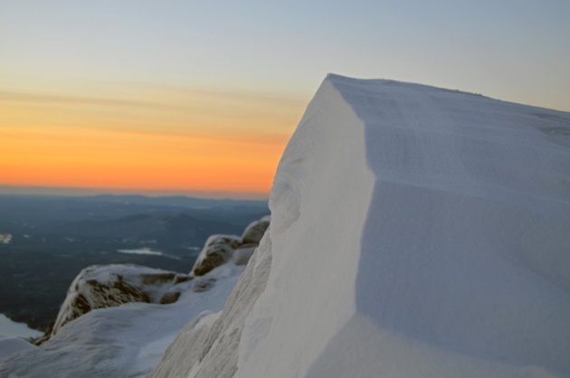 Snowy peak with sunrise in background