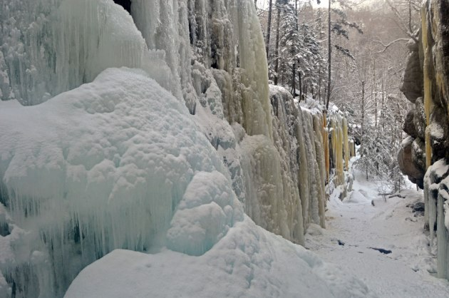 Many colored icicles hanging over waterfall
