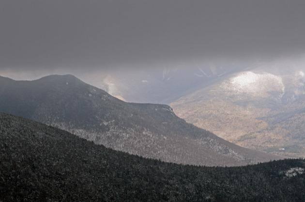 Mountain ridge under grey clouds