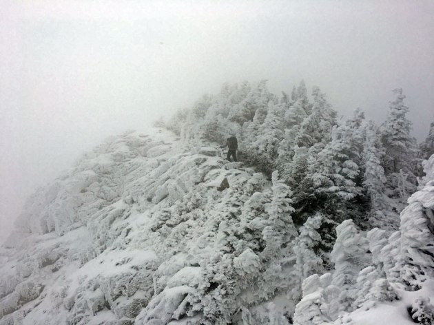 Man hiking snowy trail