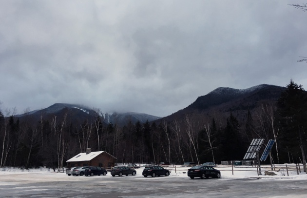 Parking lot with mountains and cloudy sky