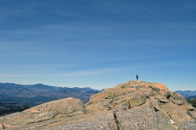 Man on rocky mountain top