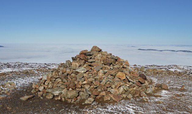 Stone pile rising above clouds