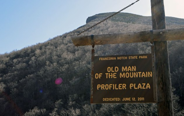 Old Man of the Mountain sign in front of mountain