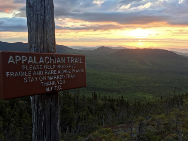 Sunrise over mountains with Appalachian Trail sign