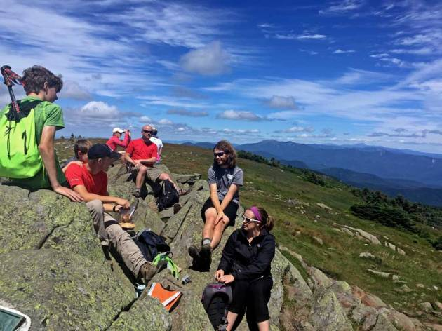 Group eating lunch on mountain top