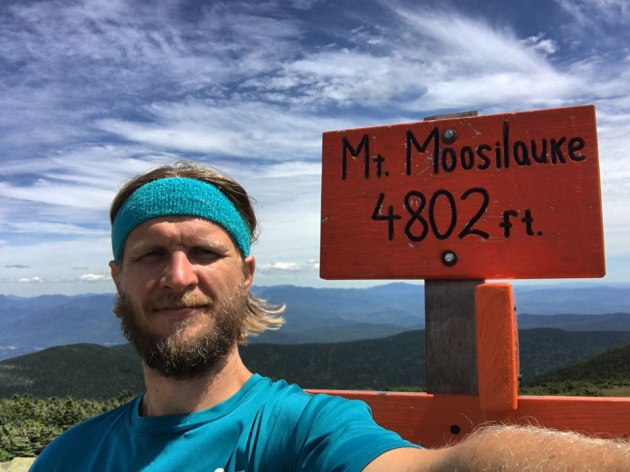 Man in front of Mount Moosilauke summit sign