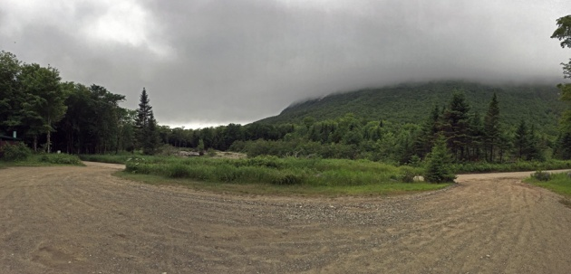 Parking lot with mountain in the clouds