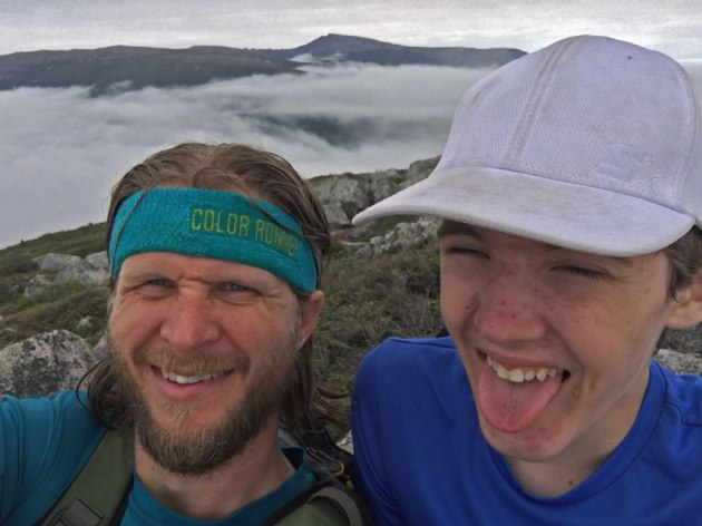 Father and son celebrating on mountain top