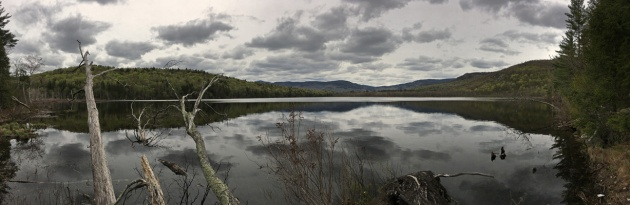 Pond with distant mountains