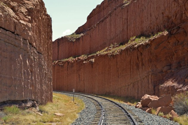 Railroad running through carved canyon